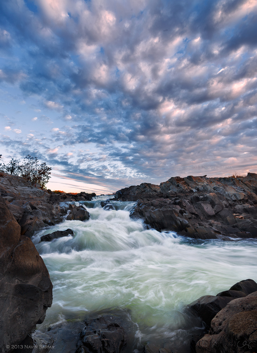 A dramatic, autumn sunrise at Great Falls National Park, Virginia.