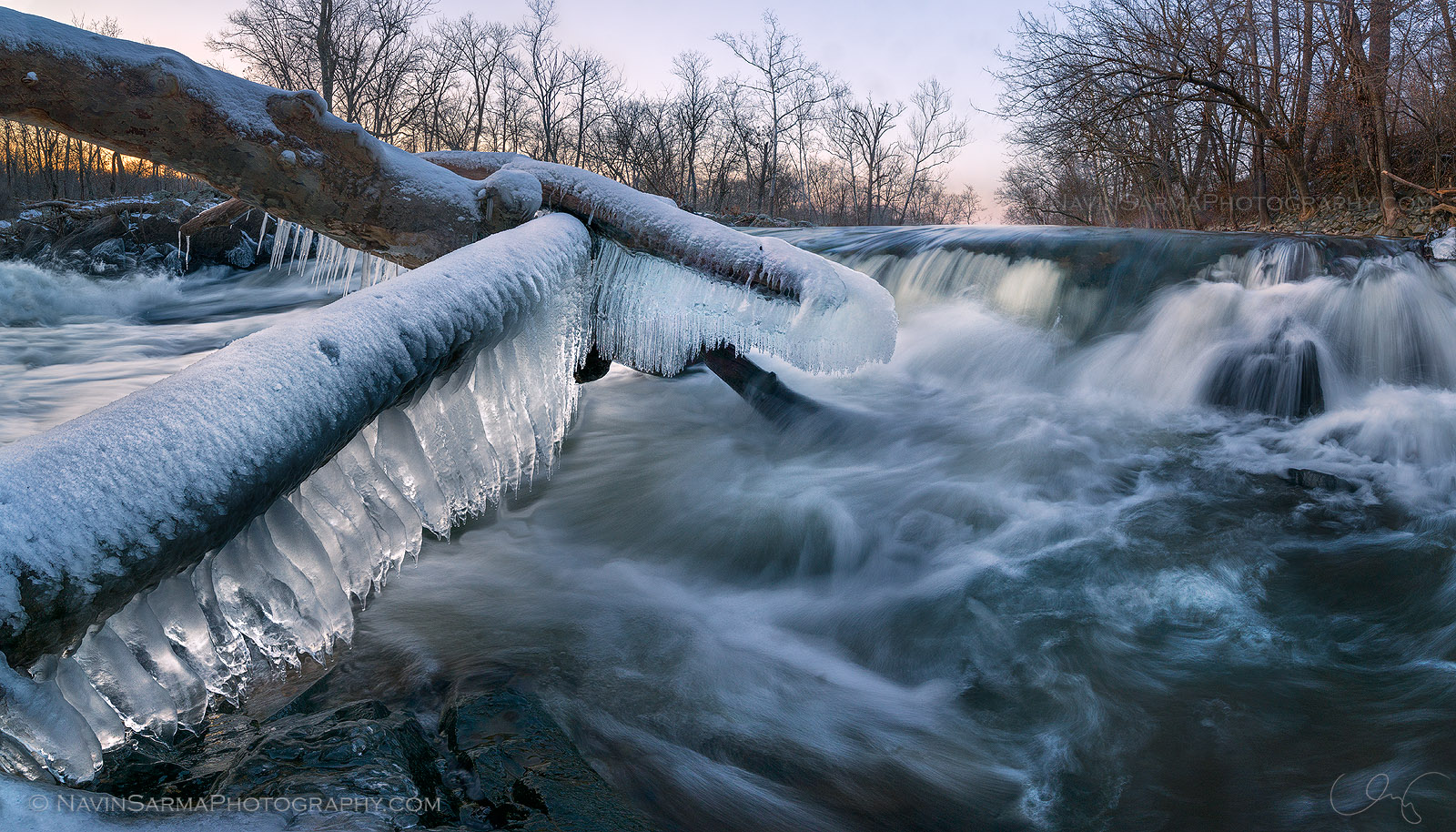 Freezing water builds a gigantic row of icicles upon fallen trees in Great Falls, Maryland.
