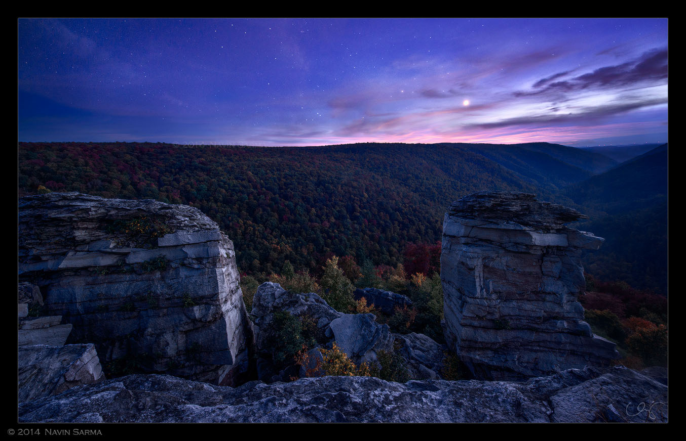 enus shines brightly during twilight over autumn trees at Lindy Point, Blackwater Falls State Park.