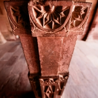 The interesting textures of a clay-colored column, in a palace in Jaipur.