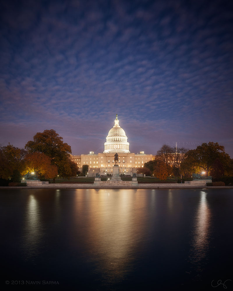 Peak fall foliage is showcased within a panorama at the U.S. Capitol and the reflecting pool