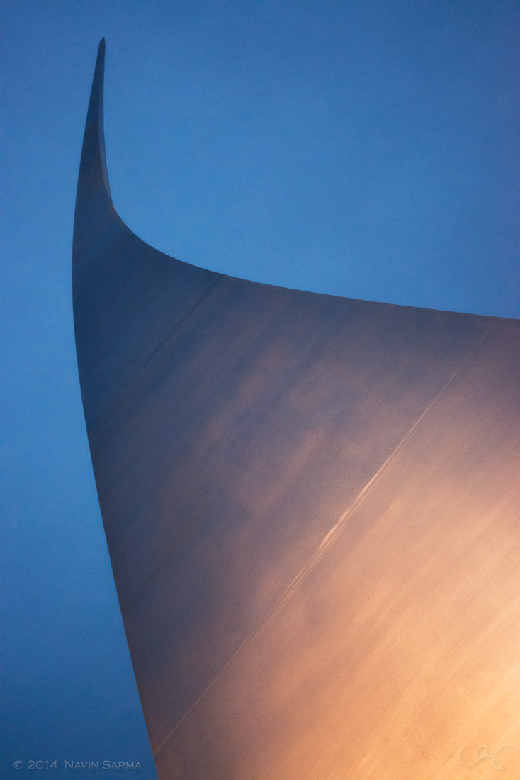 Warm light from the base of the Air Force Memorial contrasts with the blue sky of sunset.