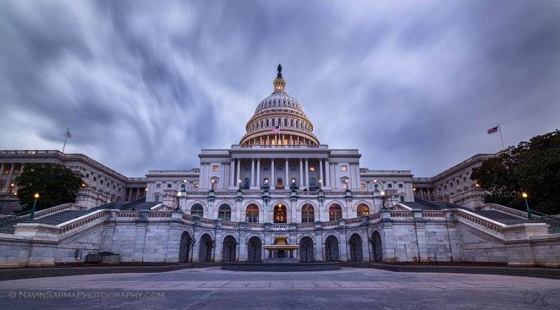 Dark storm clouds race over the U.S. Capitol just after sunset.
