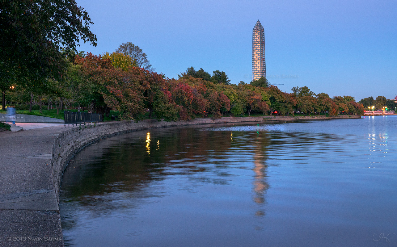Fall colors start to turn at Washington, D.C.'s Tidal Basin in front of the Washington Monument.