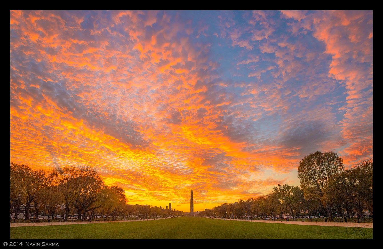 gorgeous orange consumes the western exposed sky towards the Washington Monument