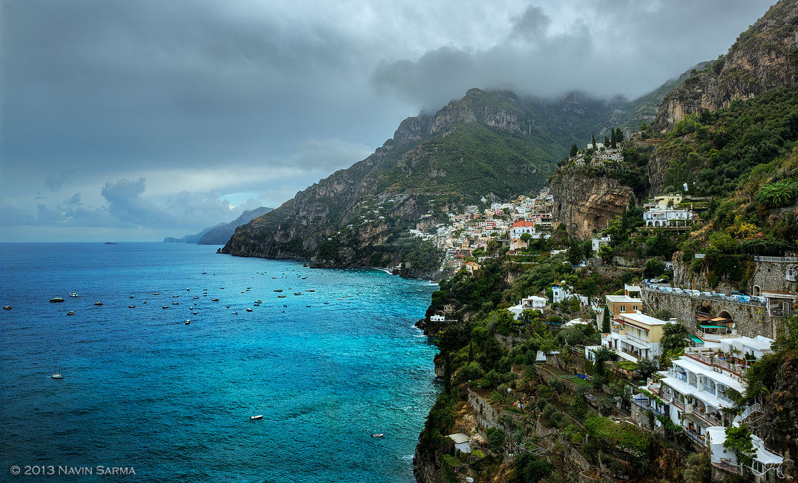 Overcast skies highlight the teal water at the Positano cliffside