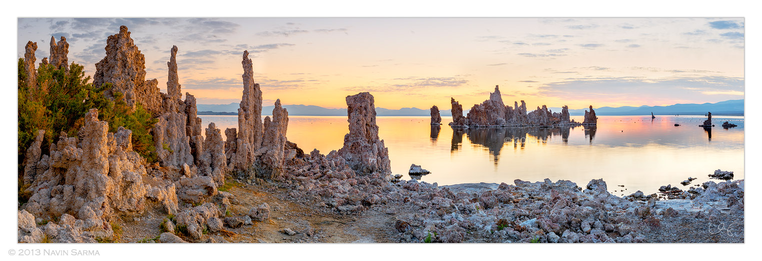 Morning light dapples impressive tufa formations surround Navy Beach at South Tufa shore of Mono Lake, California